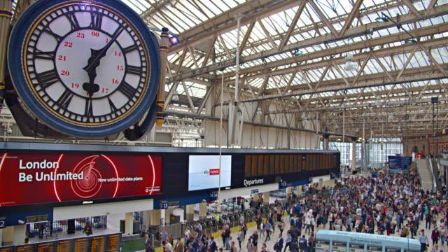 big clock at waterloo station. crowd of people. travel. - british rail stock videos & royalty-free footage