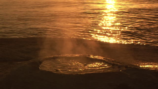stockvideo's en b-roll-footage met cu, big cone at sunrise, yellowstone lake in background, west thumb geyser basin, yellowstone national park, wyoming, usa - sepiakleurig
