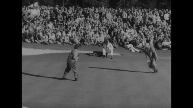Big crowd around green at Augusta National Golf Club some spectators running as play continues at the Masters Tournament / crowd / Jack Burke Jr...