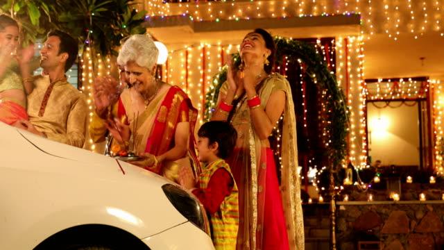 Big family buying new car in diwali festival, Delhi, India