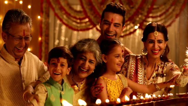 big family celebrating diwali festival, delhi, india - sari stock videos and b-roll footage