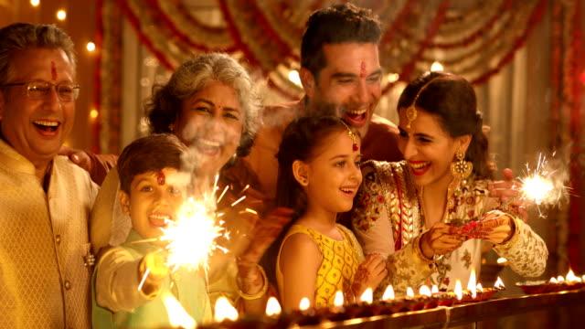 big family celebrating diwali festival, delhi, india - celebratory event stock videos & royalty-free footage