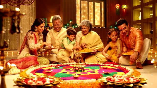 big family celebrating diwali festival, delhi, india - 床に座る点の映像素材/bロール