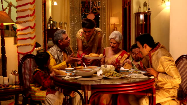 Big family eating dinner, Delhi, India