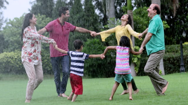 stockvideo's en b-roll-footage met big family enjoying in the rain season, delhi, india - indisch subcontinent etniciteit