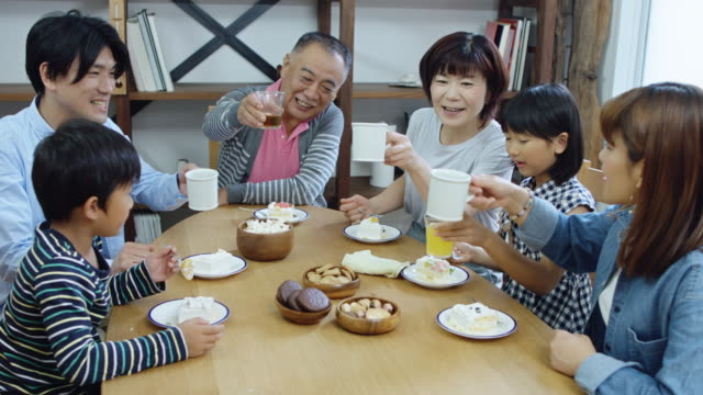 big family having tea and cake - dining table stock videos & royalty-free footage