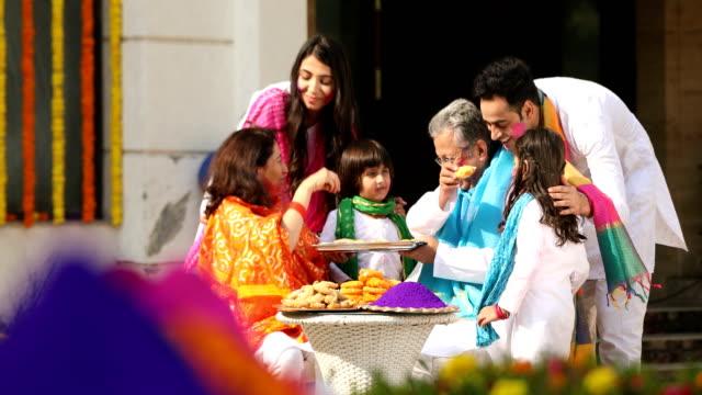 big family playing holi festival, delhi, india - sweet food stock videos & royalty-free footage