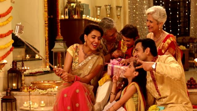 Big family taking selfie in diwali festival, Delhi, India