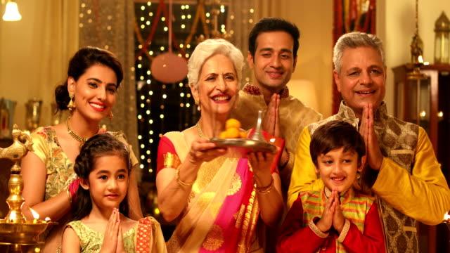 Big family worshipping in diwali festival, Delhi, India