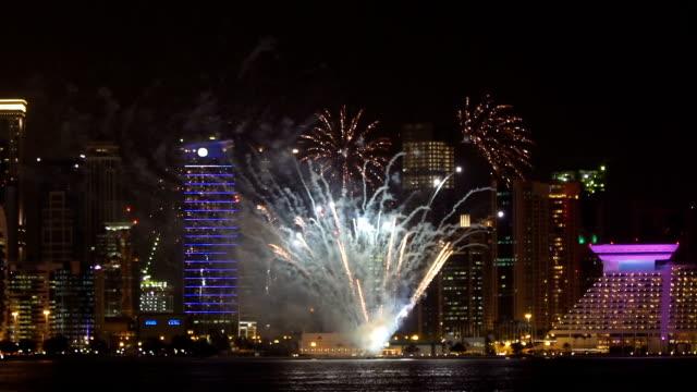 big fireworks in modern city at night - qatar stock videos & royalty-free footage
