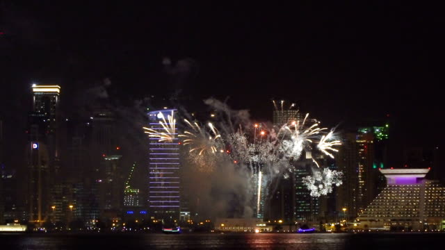 Big Fireworks in Modern City at night