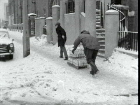 heaviest snowfall in years continues england kent milk delivered using sledge food delivered in basket - snow stock videos & royalty-free footage
