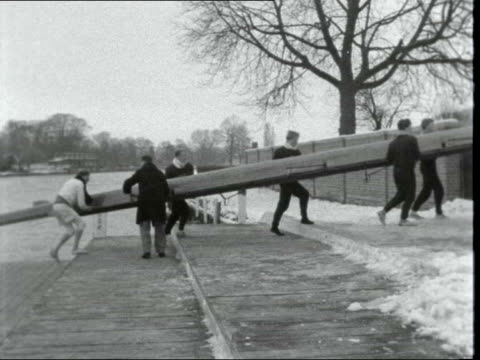 severe frosts causing ice **also a england london oxford crew along towards ms at side of river pan to snow on bank ms men carry boat across towpath... - frozen water stock videos & royalty-free footage