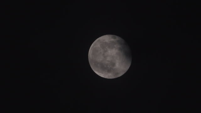 big full moon in rain cloud - hiding stock videos & royalty-free footage