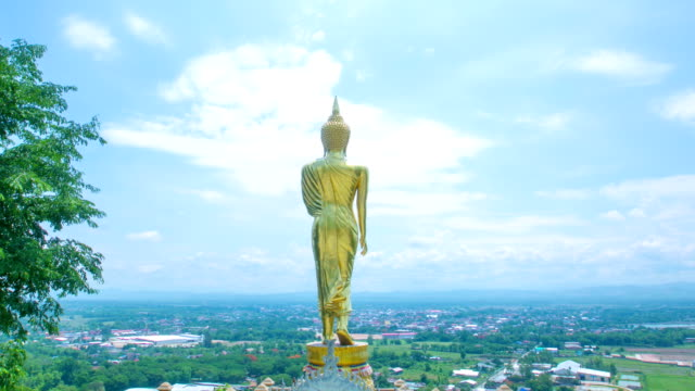 big golden stand buddha - buddha stock videos and b-roll footage