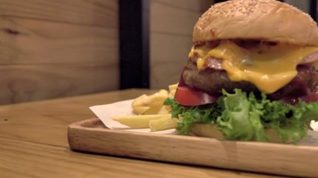 big gourmet burger with fresh ingredients - fast food stock videos & royalty-free footage