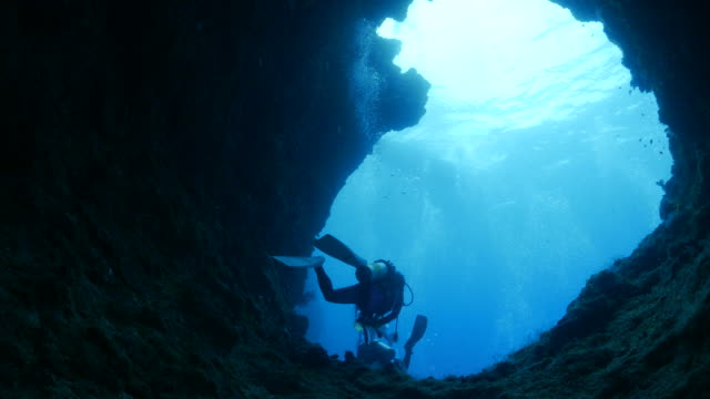 big hole of rock undersea - underwater diving stock videos & royalty-free footage