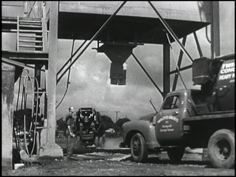 a big hulking 1950 chevrolet concrete mixer drives under a big chute to get wet cement loaded into its tank then the truck speeds along a highway and... - chevrolet truck stock videos & royalty-free footage