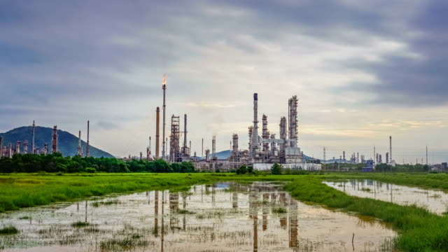 Big Industrial Oil refinery petrochemical industry plant at sunrise