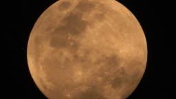 Big Orange Full Moon In Clouds