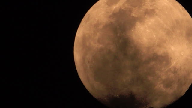 big orange full moon in clouds - supermoon stock videos & royalty-free footage