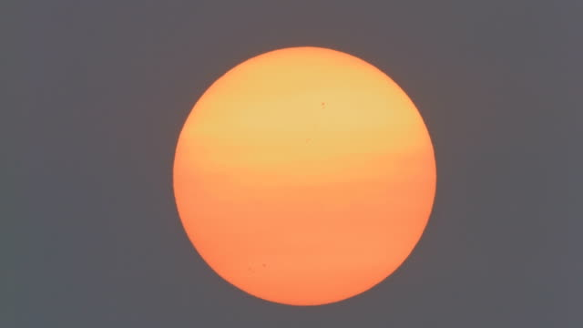 Big Orange Sun - Sunspots are Visible Without a Filter Due To Wildfire Smoke on Day of Solar Eclipse