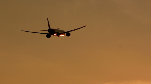 big plane landing at dusk - off stock videos & royalty-free footage