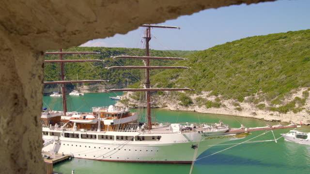 vídeos de stock, filmes e b-roll de big sailboat at calvi port, corsica - calvi