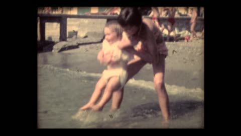 1962 big sister and baby girl in the surf - sharing stock videos & royalty-free footage