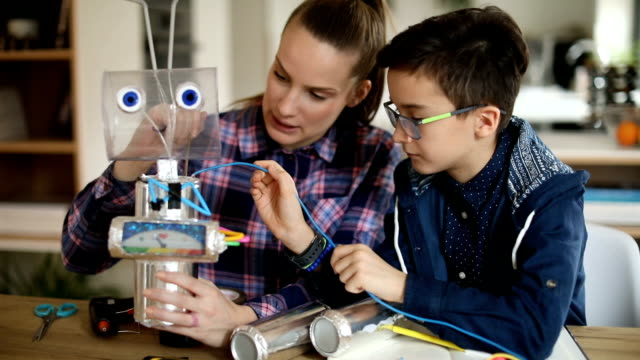 big sister and little brother making a robot together - school science project stock videos & royalty-free footage