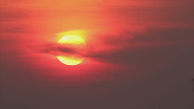 big sun in soft cloud - the end stock videos & royalty-free footage