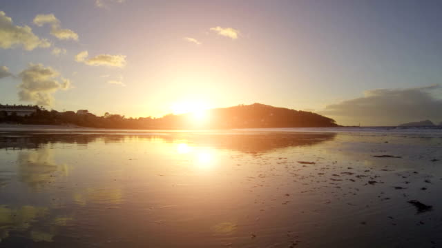 big sun on the sea at sunset - galicia stock videos & royalty-free footage