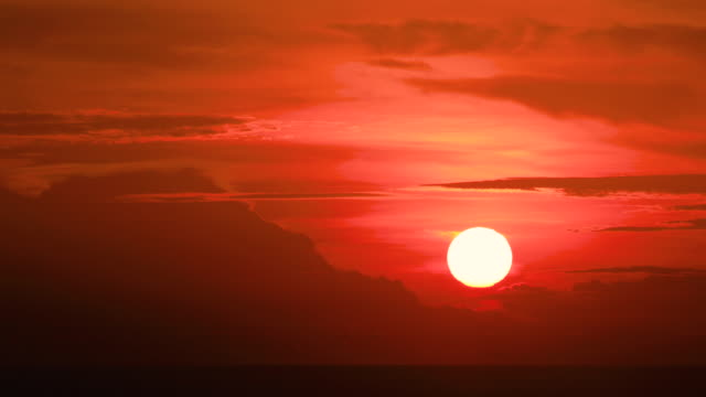 big sun with clouds sunset over water. - krabi province stock videos & royalty-free footage
