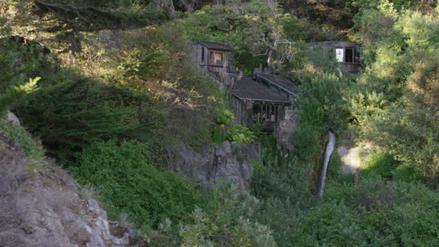 Big Sur cliff house with waterfall