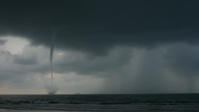 big tornado at the sea on a cloudy day - ominous stock videos & royalty-free footage