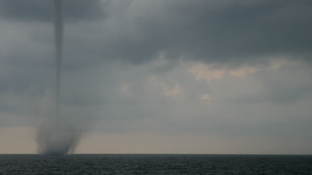 big tornado at the sea on a cloudy day