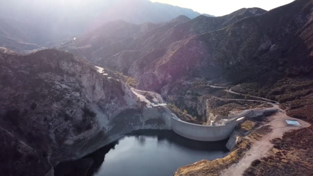 big tujunga dam, los angeles- aerial drone shot - dam stock videos & royalty-free footage