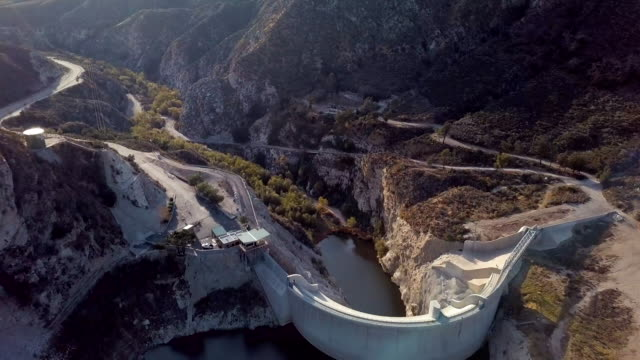 big tujunga dam, los angeles- aerial drone shot - angeles national forest stock videos and b-roll footage