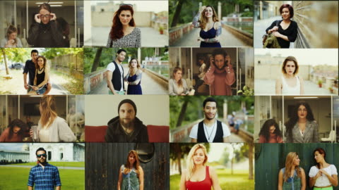 big video portrait composition: people standing up and looking at camera - large group of people stock videos & royalty-free footage