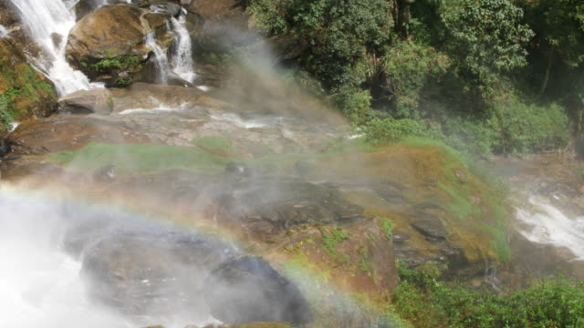 big waterfall with rainbow in the nature, 4k - national park stock videos & royalty-free footage