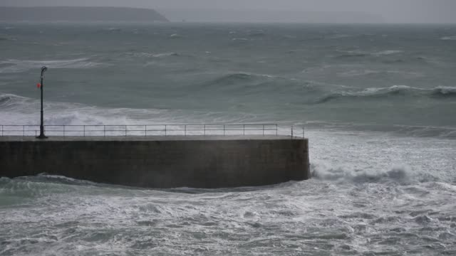 big waves brought by storm freya crash onto the coast at porthleven cornwall england uk - large stock videos & royalty-free footage