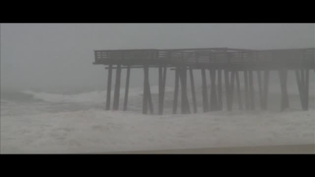 big waves crash onto a pier during hurricane katrina in new orleans on august 29 2005 in new orleans louisiana - hurricane katrina stock videos and b-roll footage