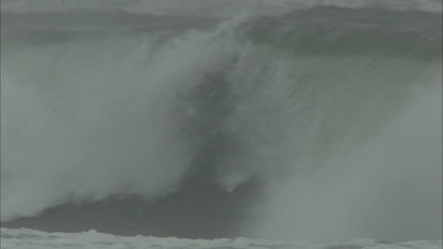 cu big waves crashing in stormy sea in the hebrides - hebrides stock videos & royalty-free footage