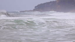 Big waves in a spanish coastal at springtime in Costa Brava, near the town Palamos, slow motion footage
