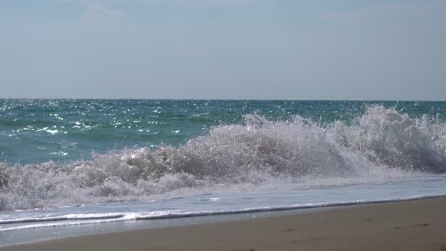 Big waves on the empty beach