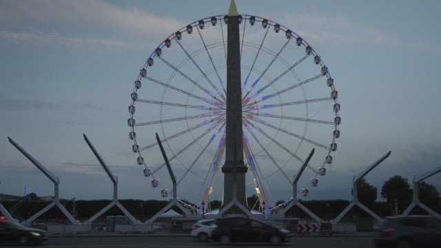 Big wheel behind obelisk in Paris