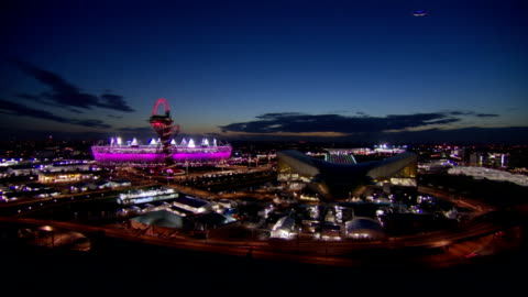stockvideo's en b-roll-footage met big wide shot of the london 2012 olympic park in the twilight hour time-lapse olympic park dusk at olympic park on august 03, 2012 in london, england - 2012