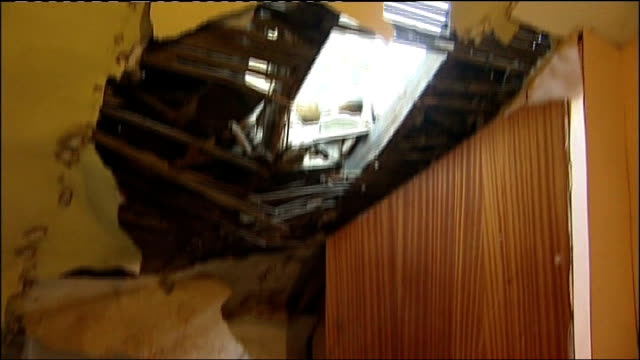vídeos de stock e filmes b-roll de biggest earthquake in 25 years felt across the uk; yorkshire: wombwell: int wrecked ceiling and rubble lying on bedroom floor rubble on floor - maior