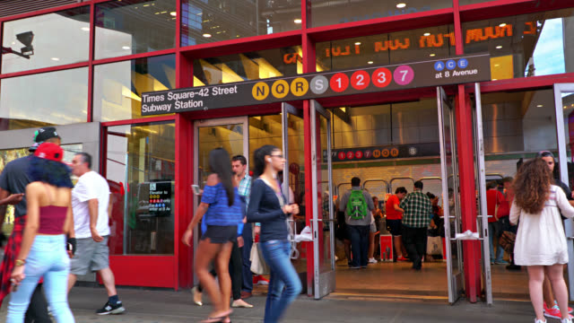 biggest subway in new york at 42 times square. travel and business. people trying to get in through the entrance. new york, us - theatre district stock videos & royalty-free footage