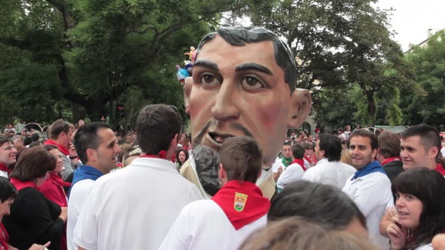 bigheaded figures dance in the cord during the taditional san fermin procession in pamplona navarra on july 7 2012 fiesta de san fermin 2012 on july... - comunidad foral de navarra stock videos and b-roll footage